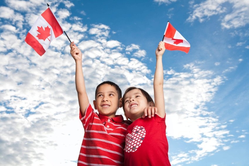 two kids with canadian flag