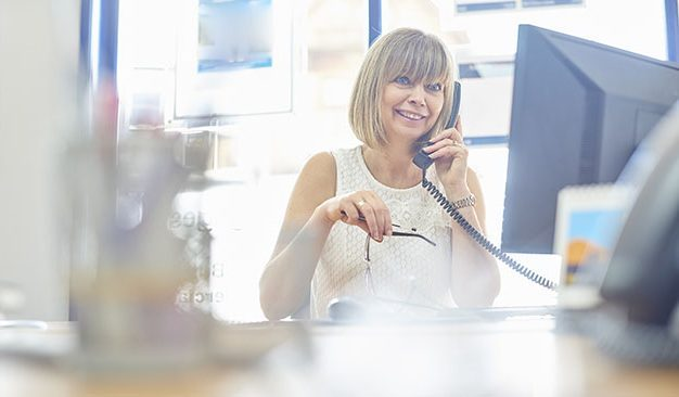 mature woman at the office on the phone