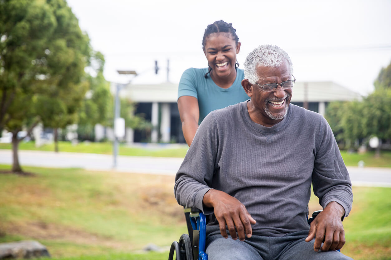 caregiver assisting client in a wheelchair