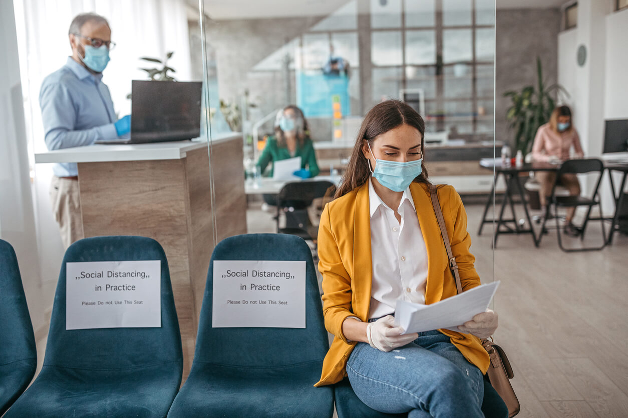 woman waiting for appointment wearing mask