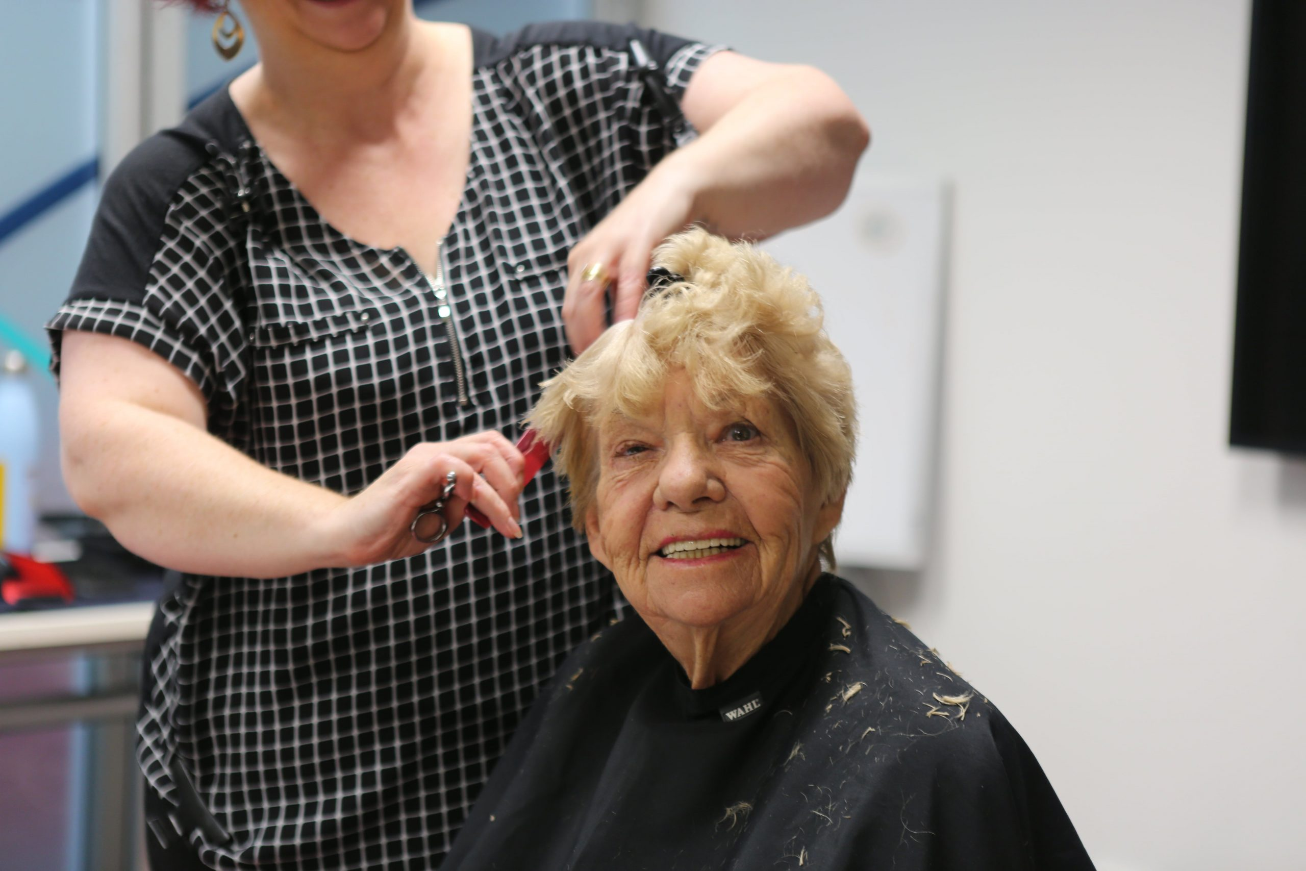 older client gets a haircut
